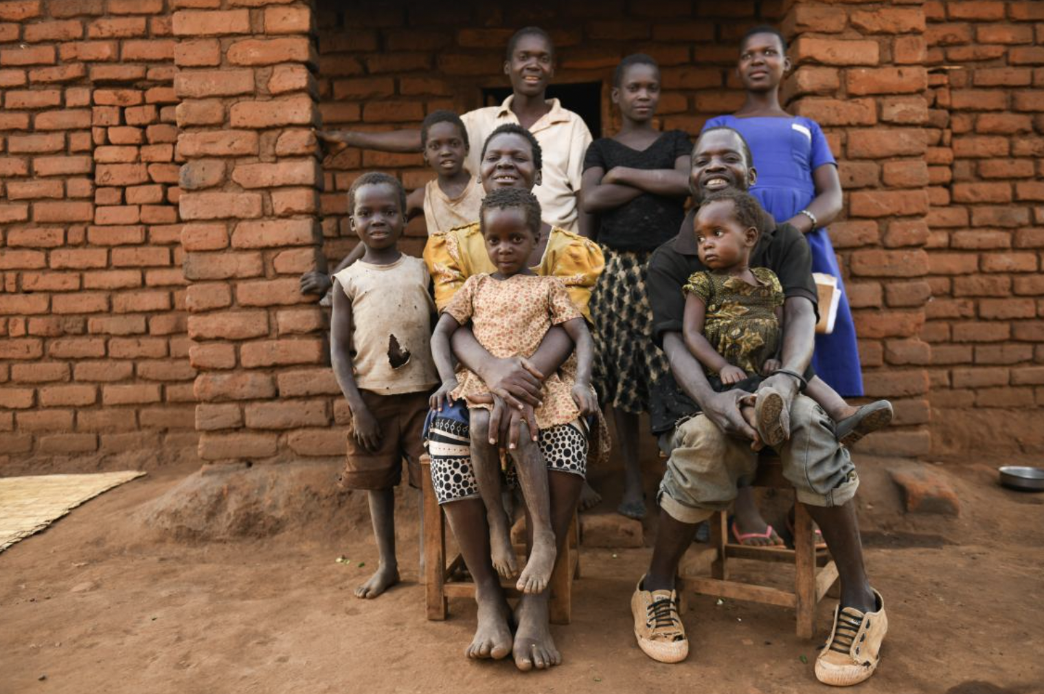 UNICEF Malawi/2020/Thoko Chikondi Sophie and her family outside their home in Balaka